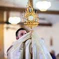 Father Keating elevates a monstrance